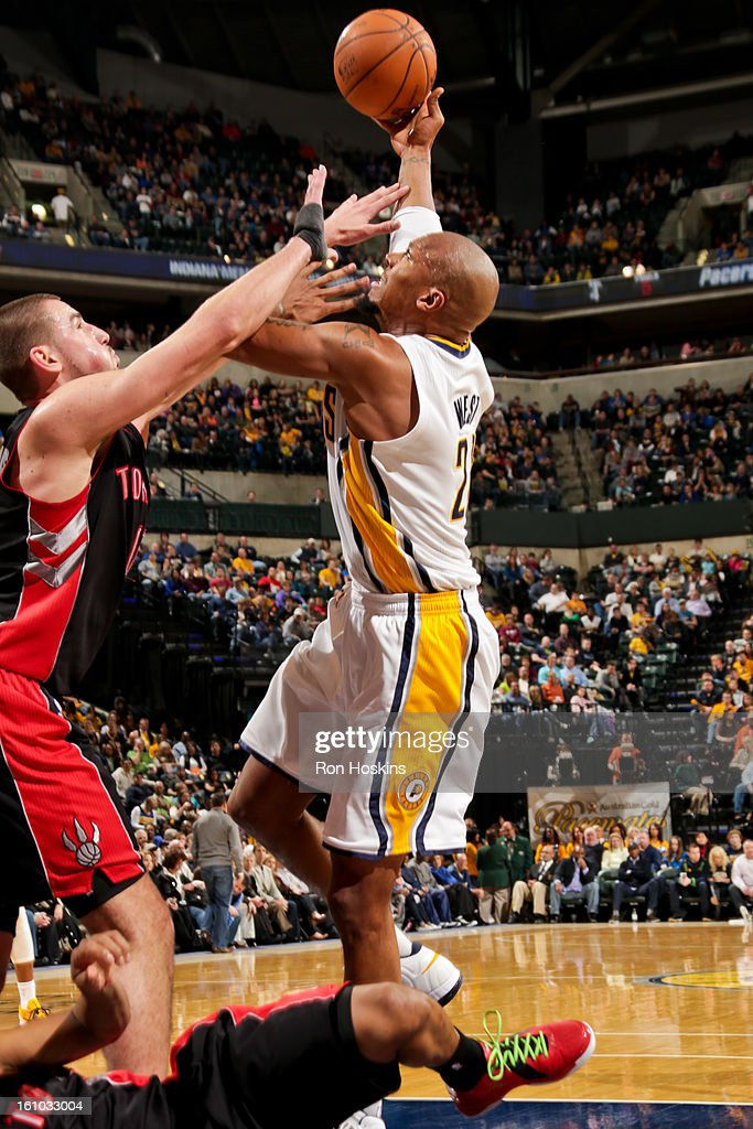 David West #21 of the Indiana Pacers shoots in the lane against <a gi-track='captionPersonalityLinkClicked' href=/galleries/search?phrase=Jonas+Valanciunas&family=editorial&specificpeople=5654195 ng-click='$event.stopPropagation()'>Jonas Valanciunas</a> #17 of the Toronto Raptors on February 8, 2013 at Bankers Life Fieldhouse in Indianapolis, Indiana.