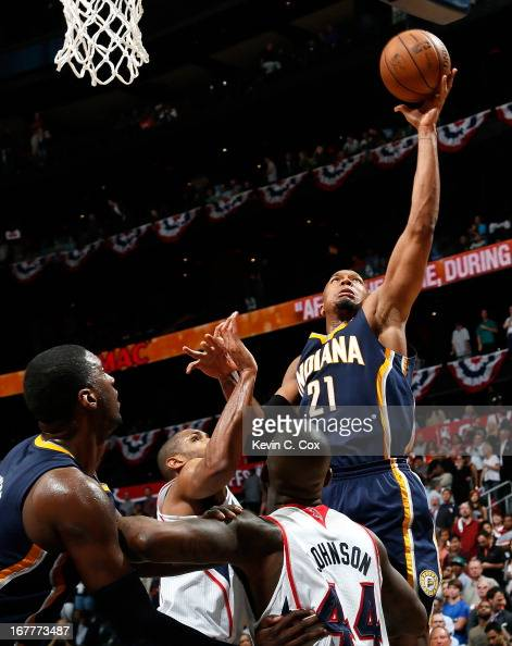 David West of the Indiana Pacers shoots over Al Horford and Ivan Johnson of the Atlanta Hawks during Game Four of the Eastern Conference...