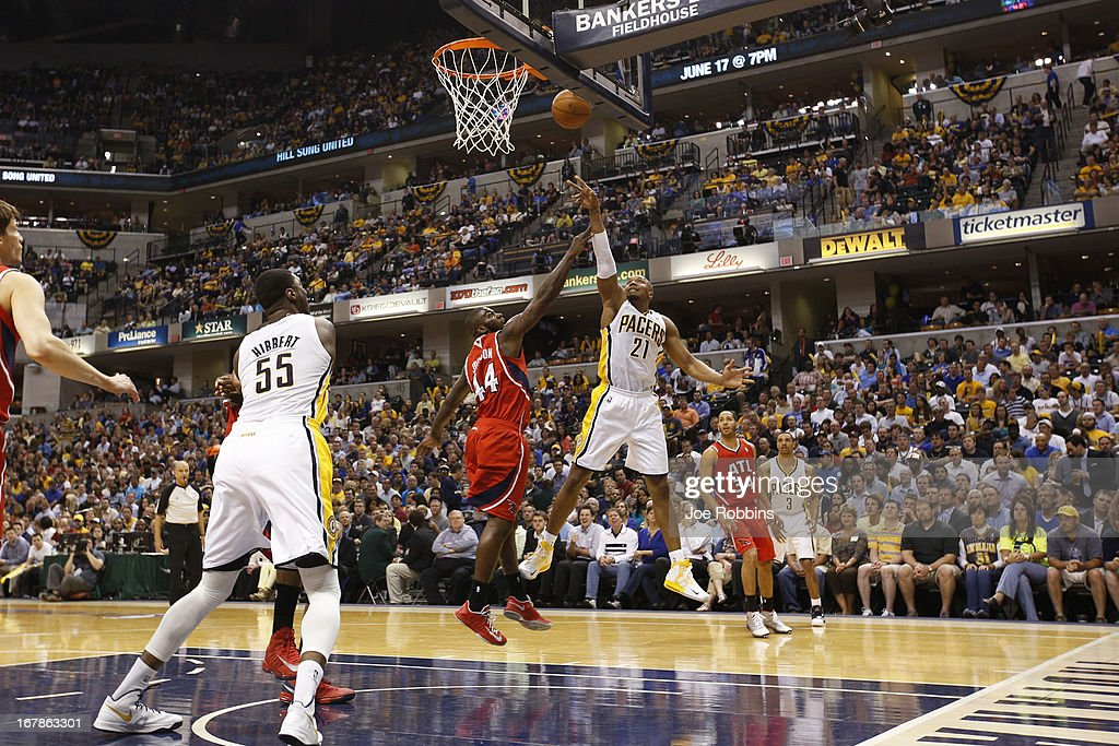 David West #21 of the Indiana Pacers shoots over Ivan Johnson #44 of the Atlanta Hawks in the first half during Game Five of the Eastern Conference Quarterfinals of the 2013 NBA Playoffs at Bankers Life Fieldhouse on May 1, 2013 in Indianapolis, Indiana.