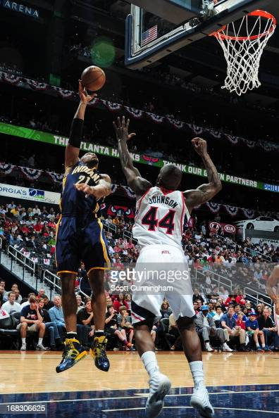 David West of the Indiana Pacers shoots over Ivan Johnson of the Atlanta Hawks in Game Three of the Eastern Conference Quarterfinals in the 2013 NBA...