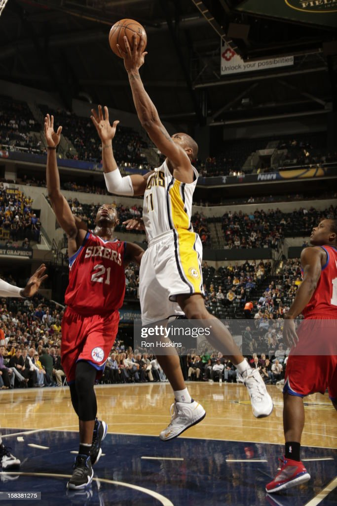 David West #21 of the Indiana Pacers shoots the ball against <a gi-track='captionPersonalityLinkClicked' href=/galleries/search?phrase=Thaddeus+Young&family=editorial&specificpeople=3847270 ng-click='$event.stopPropagation()'>Thaddeus Young</a> #21 of the Philadelphia 76ers on December 14, 2012 at Bankers Life Fieldhouse in Indianapolis, Indiana.