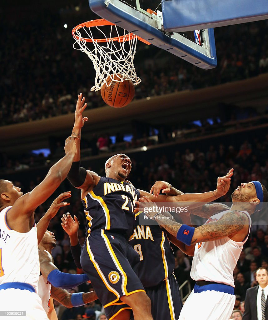 David West #21 of the Indiana Pacers sinks one against Kenyon Martin #3 of the New York Knicks at Madison Square Garden on November 20, 2013 in New York City.