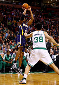 David West of the Indiana Pacers takes a shot as Vitor Faverani of the Boston Celtics defends during a game at the TD Garden on November 22 2013 in...