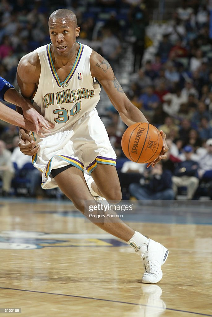 David West of the New Orleans Hornets drives against the Detroit Pistons during the game at New Orleans Arena on March 23 2004 in New Orleans...