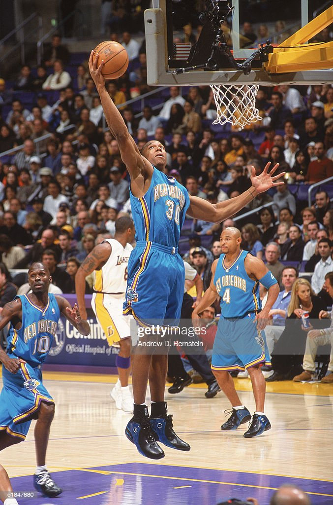 David West of the New Orleans Hornets dunks during the game against the Los Angeles Lakers at Staples Center on November 28 2004 in Los Angeles...
