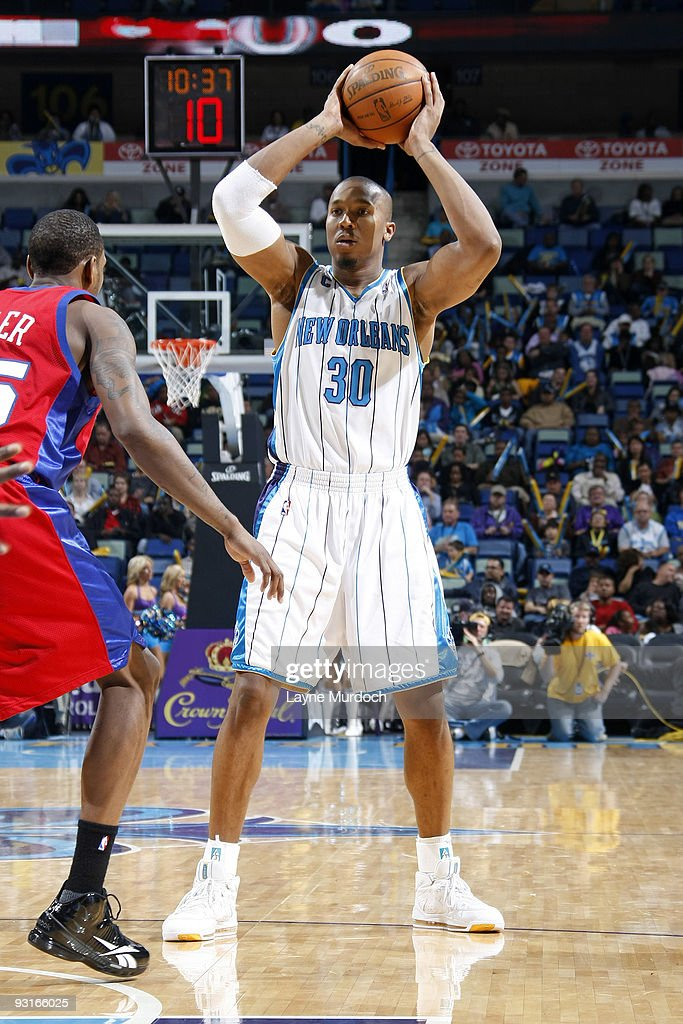 David West of the New Orleans Hornets guards the ball from Rasual Butler of the Los Angeles Clippers on November 17 2009 at the New Orleans Arena in...