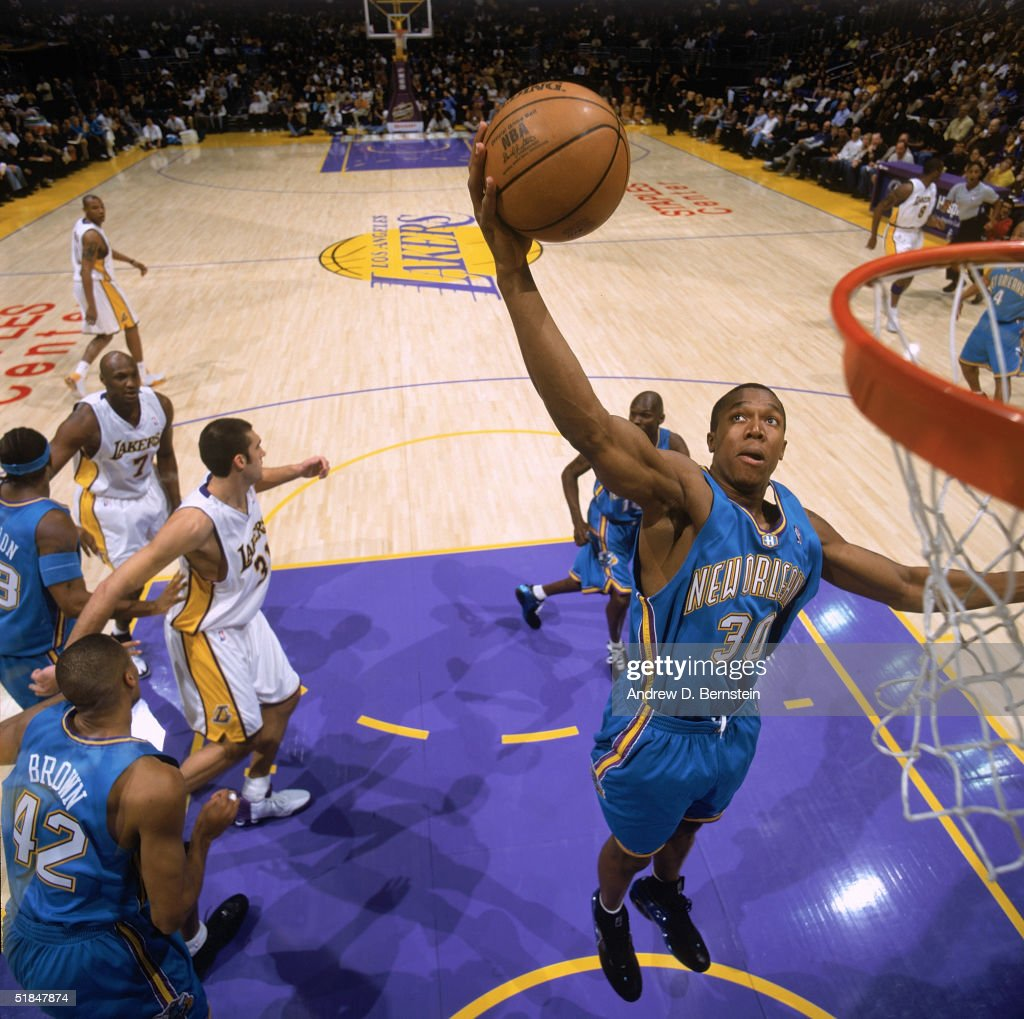 David West of the New Orleans Hornets lays up a shot during the game against the Los Angeles Lakers at Staples Center on November 28 2004 in Los...