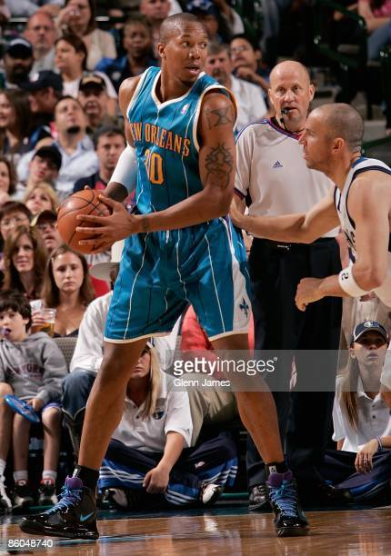 David West of the New Orleans Hornets looks to pass against Jason Kidd of the Dallas Mavericks during the game on April 10 2009 at American Airlines...