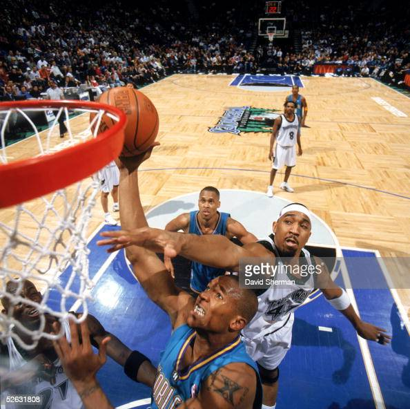 David West of the New Orleans Hornets puts up a shot against Eddie Griffin during the NBA game against the Minnesota Timberwolves at Target Center on...