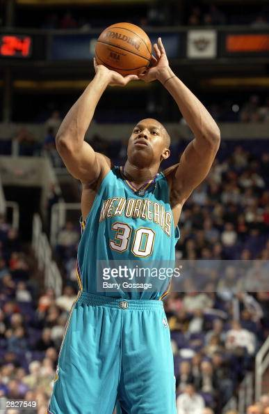 David West of the New Orleans Hornets shoots a free throw during the game against the Phoenix Suns at America West Arena on December 11 2003 in...