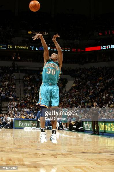 David West of the New Orleans Hornets shoots a jump shot against the Minnesota Timberwolves during a game on March 23 2005 at the Target Center in...