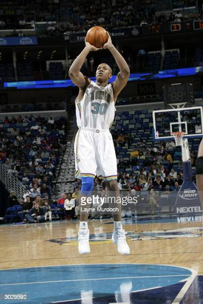 David West of the New Orleans Hornets shoots a jumper during the game against the Washington Wizards on February 18 2004 at the New Orleans Arena in...