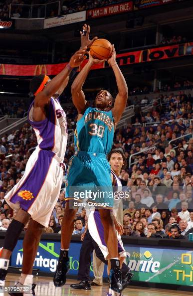 David West of the New Orleans Hornets shoots against Amare Stoudemire of the Phoenix Suns on November 26 2004 at America West Arena in Phoenix...