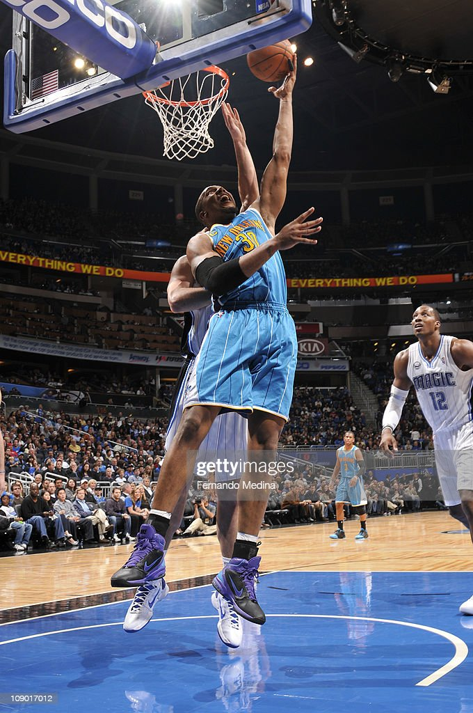 David West #30 of the New Orleans Hornets shoots against the Orlando Magic during the game on February 11, 2011 at the Amway Center in Orlando, Florida.