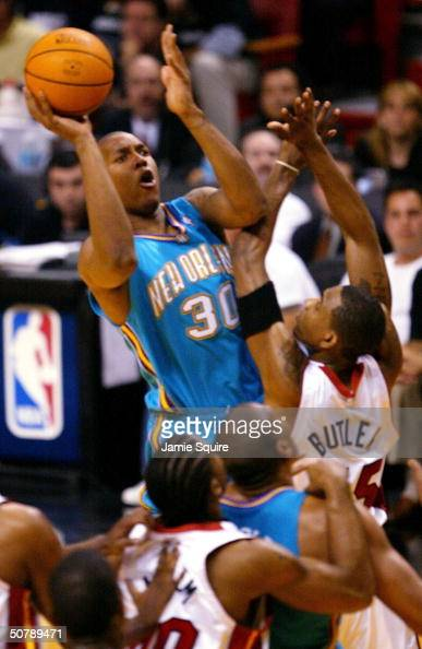 David West of the New Orleans Hornets shoots over Caron Butler of the Miami Heat during Game five of the Eastern Conference Quarterfinals of the 2004...