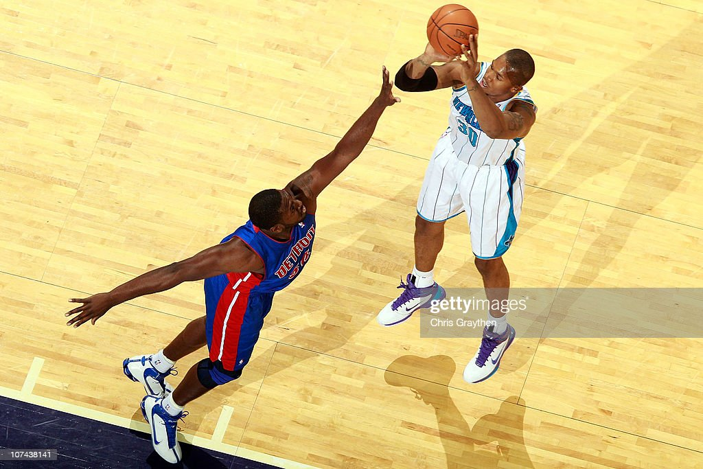 David West #30 of the New Orleans Hornets shoots the ball over Jason Maxiell #54 of the Detroit Pistons at the New Orleans Arena on December 8, 2010 in New Orleans, Louisiana.