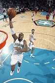 David West of the New Orleans Hornets takes the ball to the basket during the game against the Los Angeles Clippers at the New Orleans Arena on...