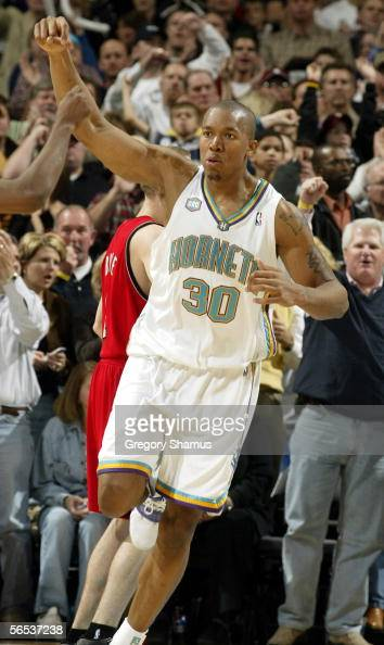 David West of the New Orleans/Oklahoma City Hornets celebrates a key fourth quarter basket against the Portland Trail Blazers during a NBA game on...