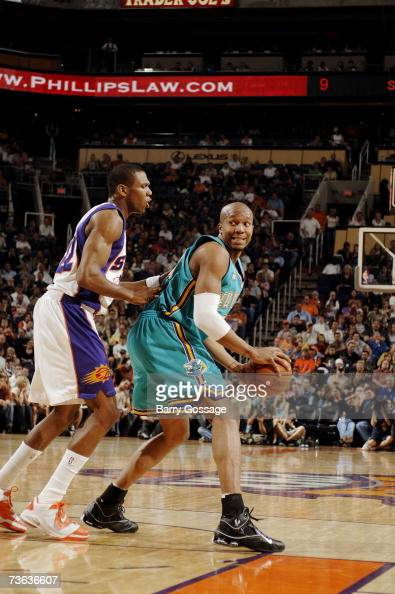 David West of the New Orleans/Oklahoma City Hornets looks to move the ball against James Jones of the Phoenix Suns during the game on March 9 at US...