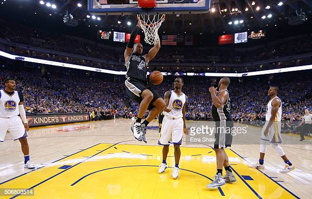 David West of the San Antonio Spurs dunks the ball on Harrison Barnes of the Golden State Warriors at ORACLE Arena on January 25 2016 in Oakland...