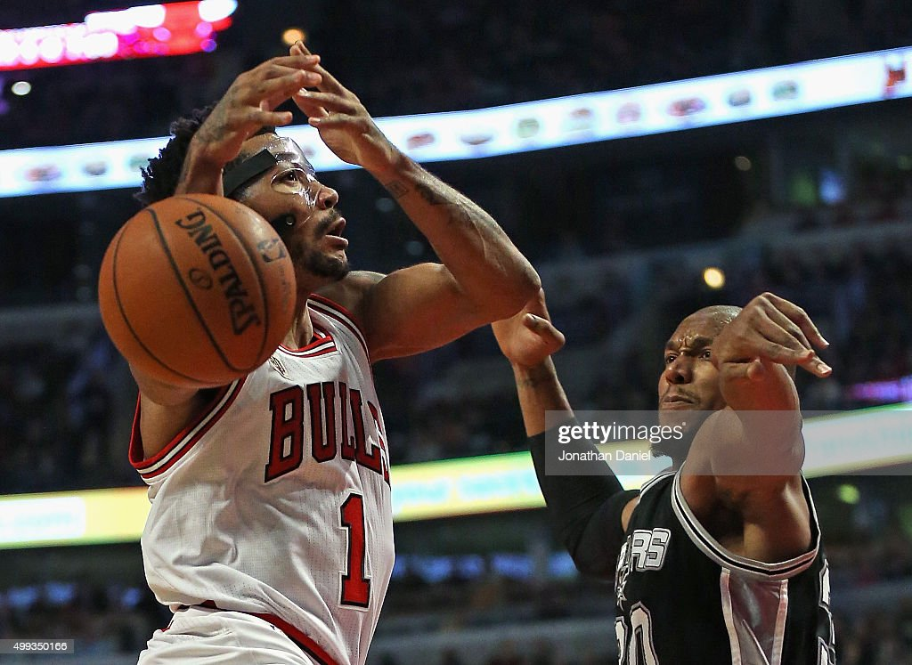 David West #30 of the San Antonio Spurs knocks the ball away from Derrick Rose #1 of the Chicago Bulls at the United Center on November 30, 2015 in Chicago, Illinois. Note to User: User expressly acknowledges and agrees that, by downloading and or using the photograph, User is consenting to the terms and conditions of the Getty Images License Agreement.