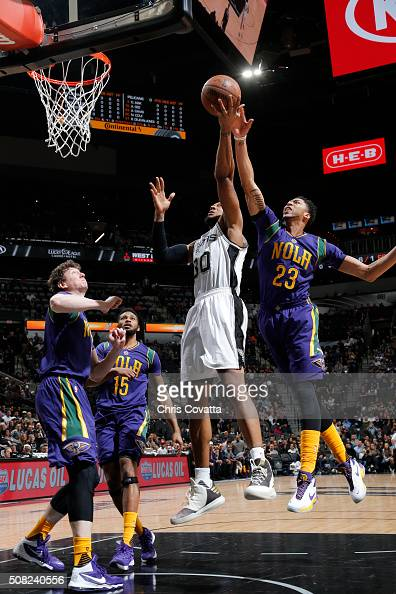 David West of the San Antonio Spurs shoots the ball against Anthony Davis of the New Orleans Pelicans on February 3 2016 at the ATT Center in San...