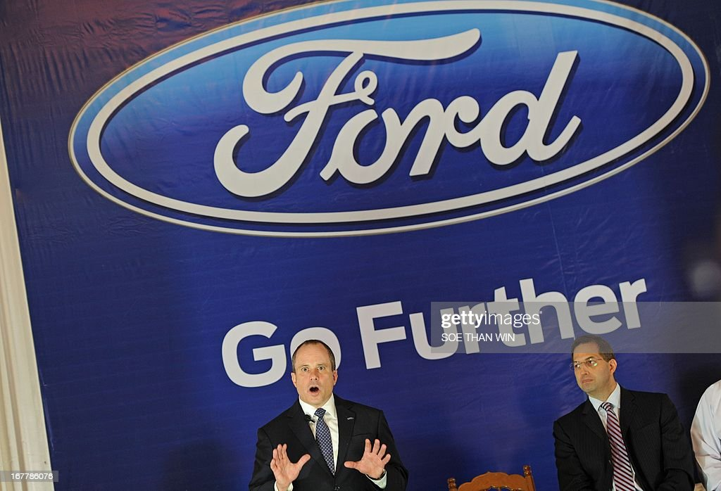 David Westerman (L), Regional manager of Asia Pacific for Ford export and growth operations speaks during an event by US carmaker Ford in Yangon on April 30, 2013. US carmaker Ford announced plans on April 30 to enter into the Myanmar market as sanctions have eased following democratic reforms in 2012. AFP PHOTO/ Soe Than WIN