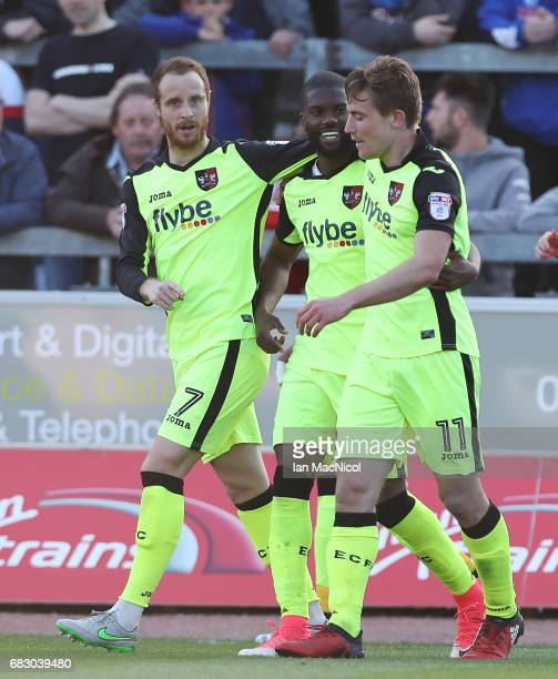 David Wheeler of Exeter City celebrates with team mate Joel Grant after he scores his team's third goal during the Sky Bet League Two match between...