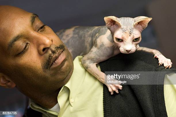 David White of Wayne New Jersey holds his Grand Champion sphynx Good Golly Miss Molly at a press preview for the 6th Annual CFA Iams Cat Championship...