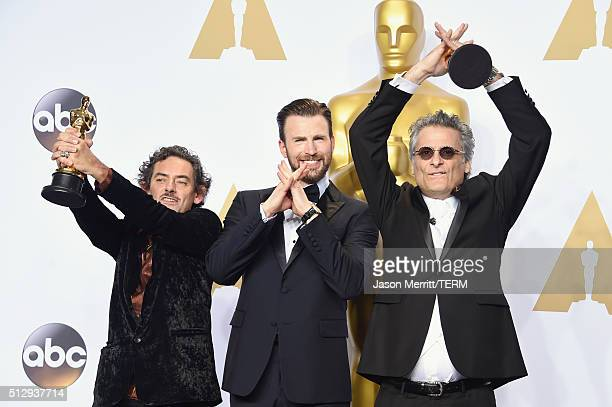 David White winner of the Best Sound Editing award for 'Mad Max Fury Road' actor Chris Evans and Mark A Mangini winner of the Best Sound Editing...