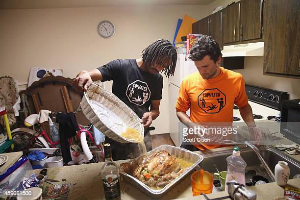 David Whitt and Jacob Crawford prepare a turkey for Thanksgiving dinner on November 27 2014 in Ferguson Missouri Whitt lives in the Canfield Green...