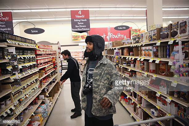 David Whitt and Jacob Crawford shop groceries for Thanksgiving dinner on Thanksgiving Day November 27 2014 near Ferguson Missouri Whitt lives in the...