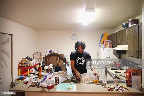 David Whitt helps to prepare a turkey for Thanksgiving dinner on November 27 2014 in Ferguson Missouri Whitt lives in the Canfield Green Apartments...