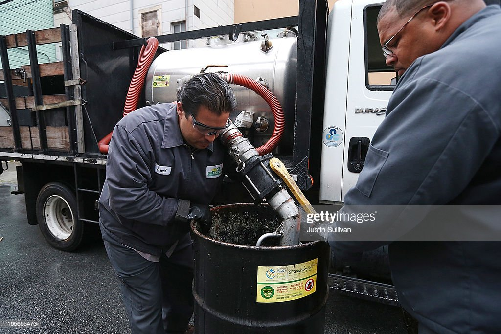 David Wicks (L) and Glendon Johnson (R) with the San Francisco Water Power and Sewer's SFGreasecycle use a hose to transfer used oil from a drum into a grease collection truck on April 5, 2013 in San Francisco, California. Launched in 2007, SFGreasecycle is a program that will collect used cooking oil from San Francisco restaurants to be recycled into biofuels and also keeps oils from entering the city's sewer system. According to a recent report by San Francisco based nonprofit group Next 10, California continues to be the nation's leader in venture capital funding for green technology, green tech patents and the growth in clean power generation, resulting in reduced greenhouse gas emissions despite a growth in population.
