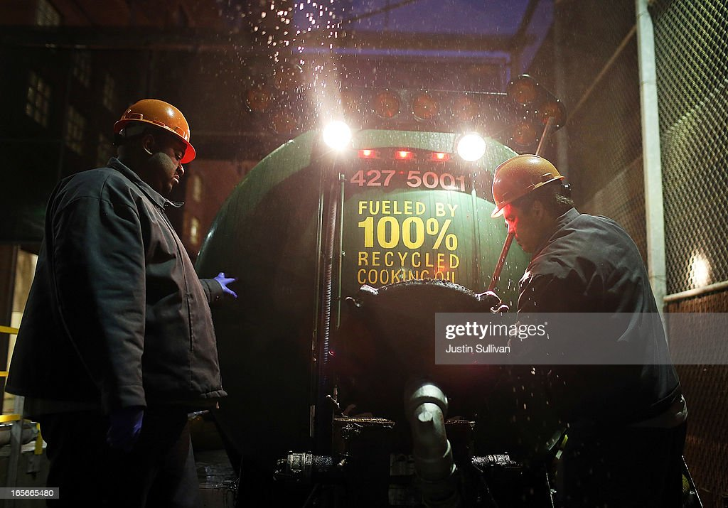 David Wicks and Glendon Johnson with the San Francisco Water Power and Sewer's SFGreasecycle clean out the filter of a grease collection truck on...