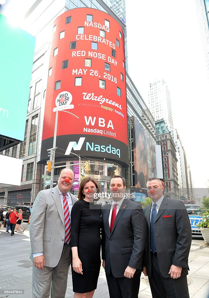 David Wicks, Vice President at NASDAQ OMX; Christy Gibb, Board of Trustees, Comic Relief, the non-profit behind Red Nose Day; Skip Bourdo, Corporate Operations Vice President of Walgreens and Stephen Chalmers, Managing Director at NASDAQ visit The NASDAQ Opening Bell In Celebration Of Red Nose Day at NASDAQ MarketSite on May 26, 2016 in New York City.