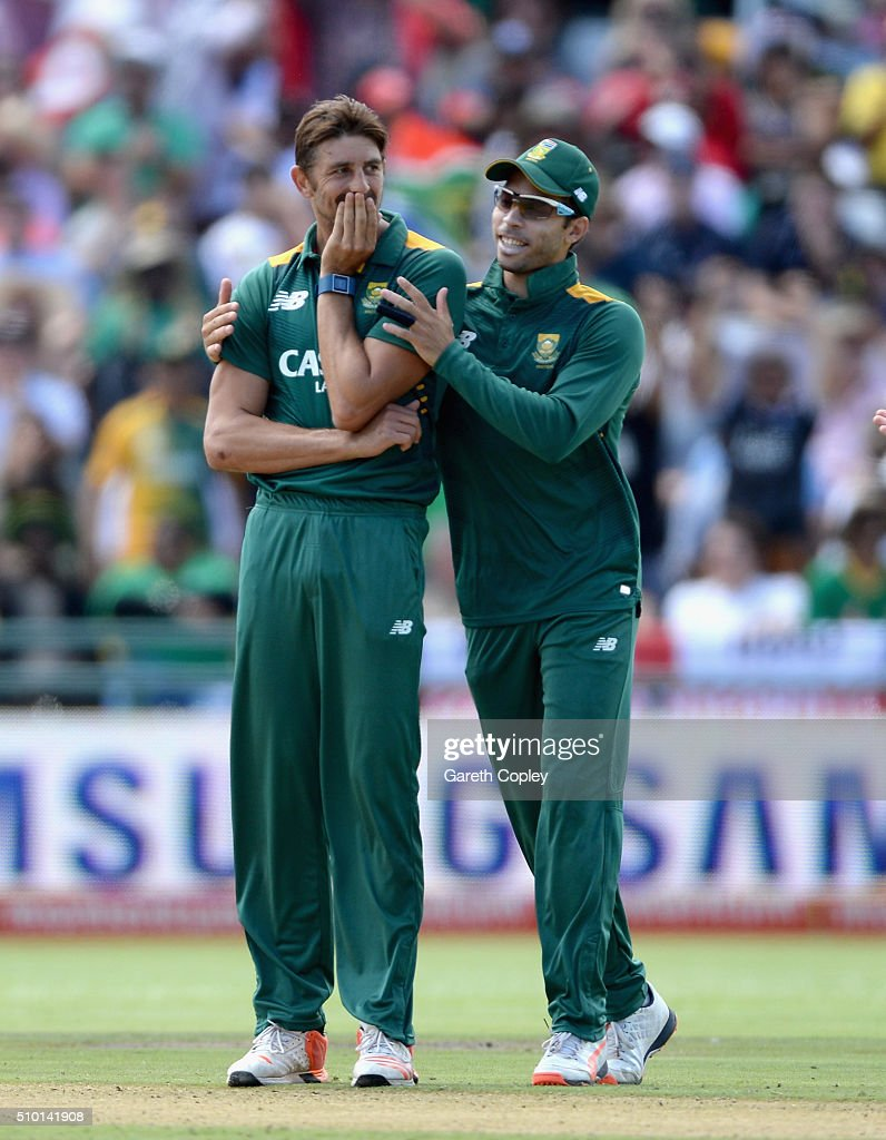 David Wiese of South Africa celebrates with Farhaan Behardien after dismissing Chris Woakes of England during the 5th Momentum ODI match between South Africa and England at Newlands Stadium on February 14, 2016 in Cape Town, South Africa.