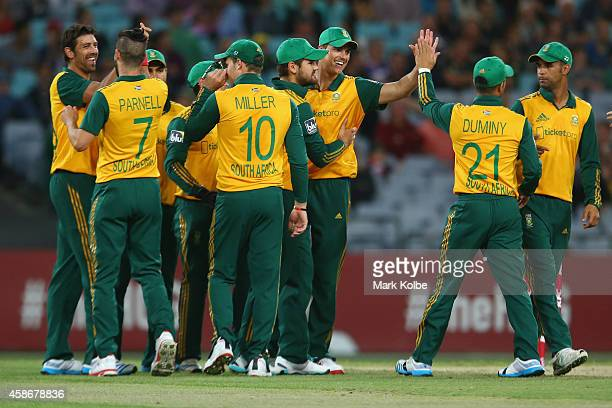 David Wiese of South Africa celebrates with his team mates after combining with Marchant De Lange of South Africa to take the wicket of Aaron Finch...