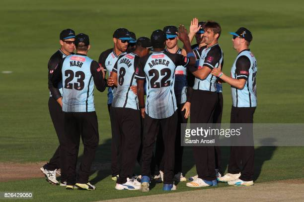 David Wiese of Sussex Sharks is congratulated by his teammates after dismissing Daniel Bell_Drummond of Kent Spitfires during the match between Kent...