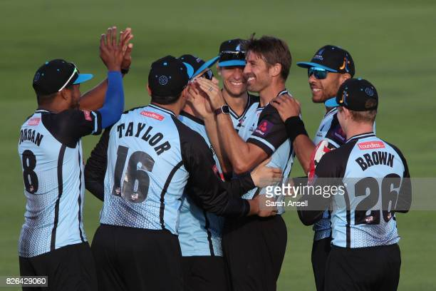 David Wiese of Sussex Sharks is congratulated by his teammates after bowling Joe Denly of Kent Spitfires with the first ball of the match between...