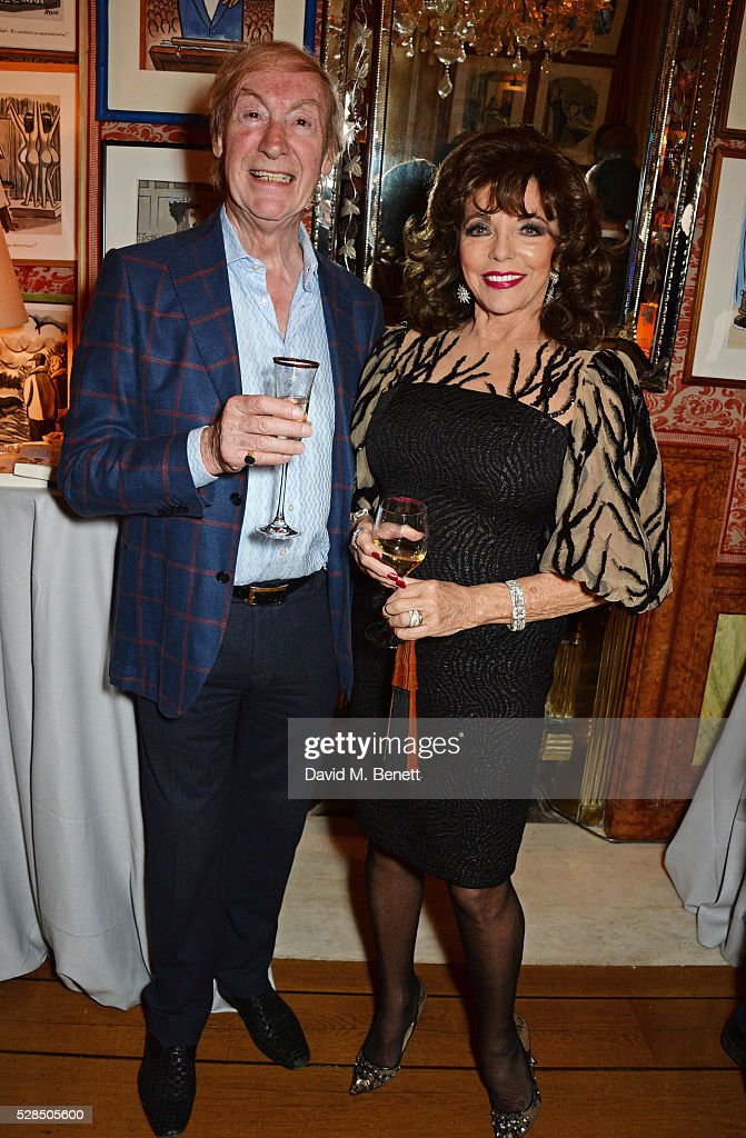 David Wigg (L) and Dame Joan Collins attend the launch of Dame Joan Collins' new book 'The St. Tropez Lonely Hearts Club' at Harry's Bar on May 5, 2016 in London, England.