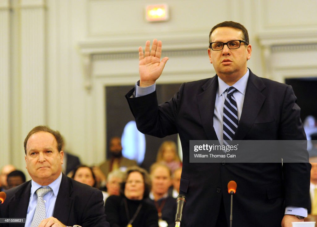 David Wildstein (R) former director of interstate capital projects for the Port Authority and his attorney Alan Zegas (L) is sworn in to testify at a hearing held by the Assembly Transportation Committee January 9, 2014 in Trenton, New Jersey, Pennsylvania. The committee has subpoenaed David Wildstein former director of interstate capital projects for the Port Authority to testify about the agency's decision to temporarily close some access lanes to the George Washington Bridge in Fort Lee in September 2013.