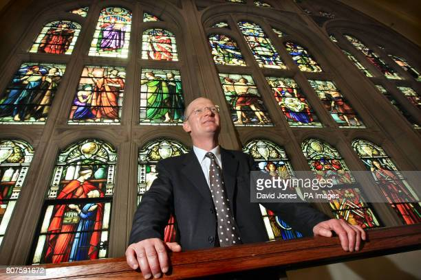 David Willetts Minister for Universities and Science at the stained glass window in the Great Hall at Birmingham University which his great...