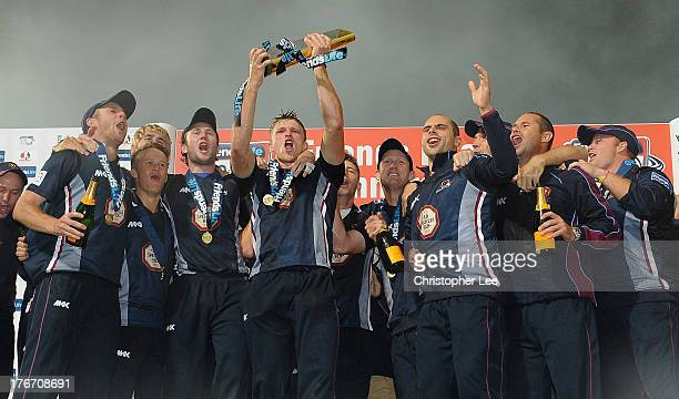 David Willey holds aloft the Friends Life Trophy as Northants Steelbacks celebrate winning during the Friends Life T20 Final match between Surrey...