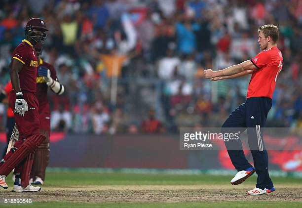 David Willey of England celebrates after taking the wicket of Darren Sammy Captain of the West Indies during the ICC World Twenty20 India 2016 Final...