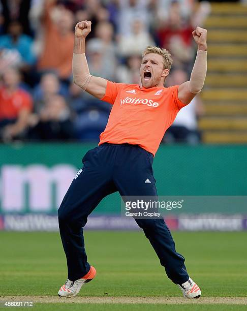 David Willey of England celebrates dismissing Australian captain Steven Smith during the NatWest T20 International match between England and...