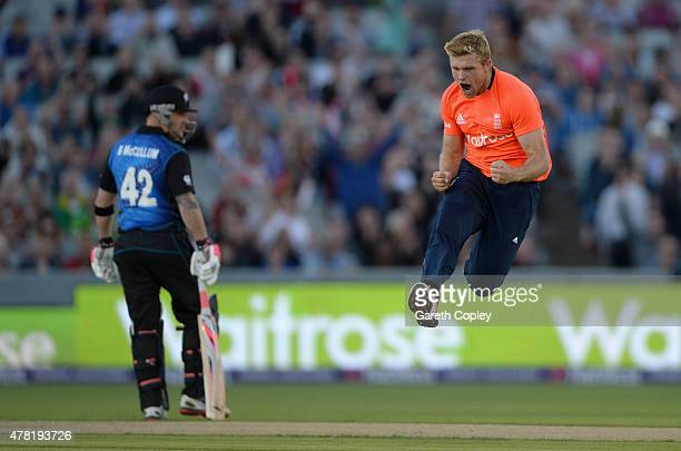 David Willey of England celebrates dismissing Martin Guptill of New Zealand during the NatWest International Twenty20 match between England and New...