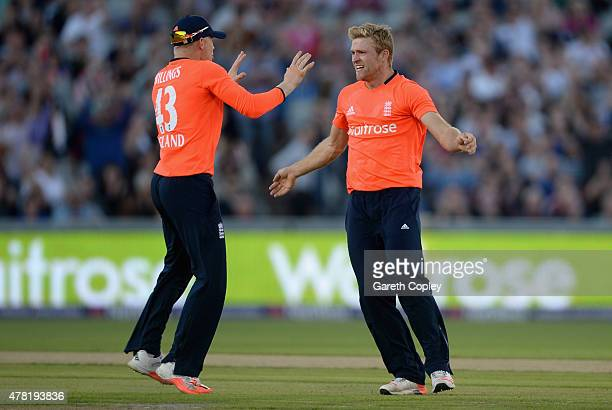 David Willey of England celebrates with Sam Billings of England after dismissing Martin Guptill of New Zealand during the NatWest International...