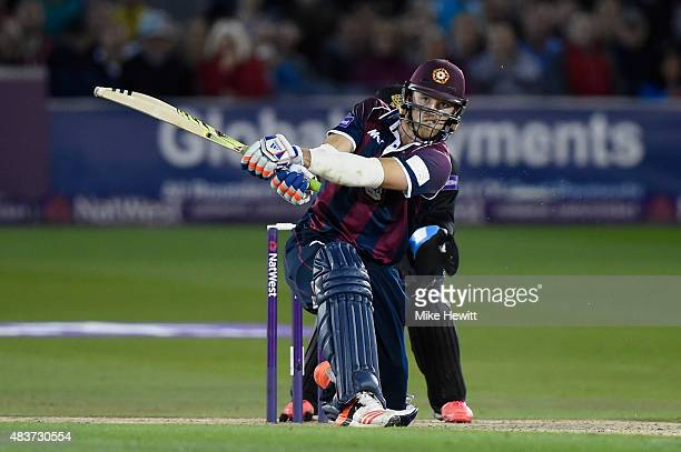 David Willey of Northamptonshire hits a six off the bowling of Michael Yardy during the NatWest T20 Blast Quarter Final between Sussex Sharks v...