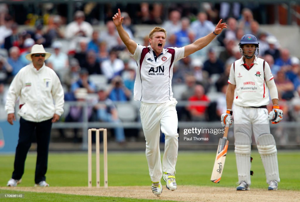 David Willey (C) of Northants celebrates after taking the wicket of Lancashire's Luis Reece (not pictured) during day one of the LV County Championship Division Two match between Lancashire and Northamptonshire at Old Trafford on June 20, 2013 in Manchester, England.